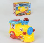 Музыкальный паровоз на батарейках SHUN DU QS152 Желтый (2-78719)