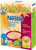 Каша молочная Nestle Пшеничная с яблоком 7613035686786 200 г