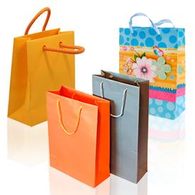 Подарункові пакети і мішечки